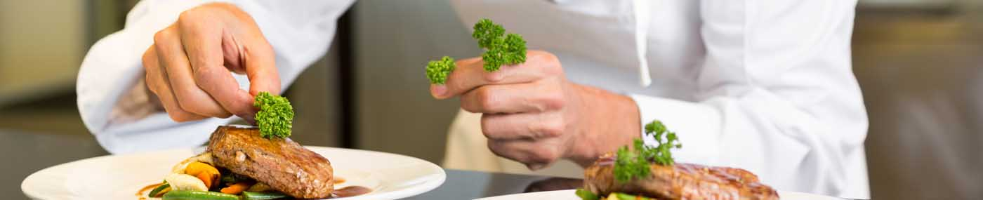 Culinary Student Plating a Dish