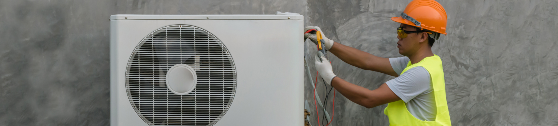 HVAC student working on an air conditioner unit.