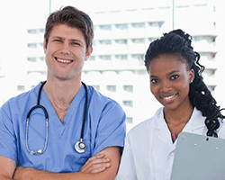 who do medical assistants work under