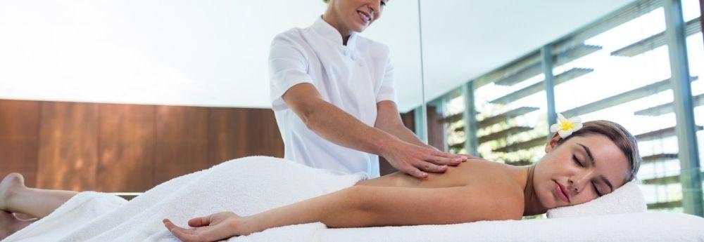 Massage therapist massaging a person.