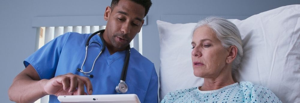 LPN staff consulting an older woman.