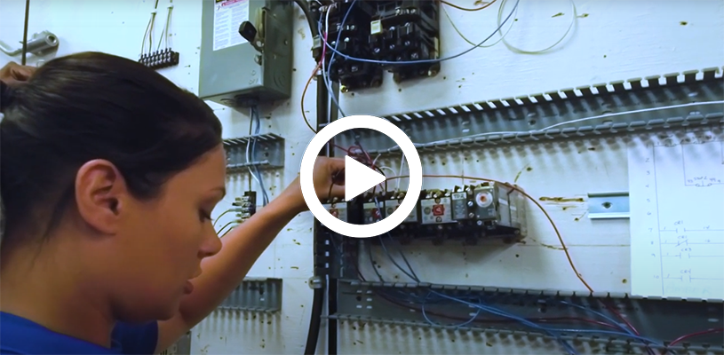 Video play button with an electrical technician student training.