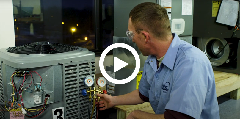 Video play button with an HVAC Training instructor on an A/C unit.