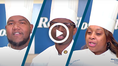 Video play button with Roseville Culinary Academy graduates John, Walter, and Julia.