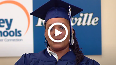 A video play button with Medical Administration and Billing graduate LaShaun.